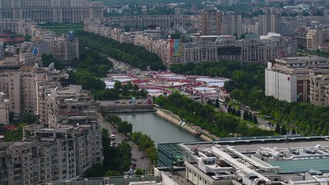 Aerial Romania Bucharest June 2018 Sunny Day 90mm Zoom 4K Inspire 2 Prores  Aerial video of downtown Bucharest in Romania on a beautiful sunny day with a zoom lens