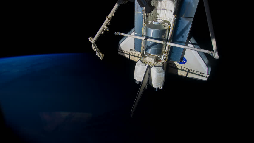 Beautiful time lapse of over the Earth from International Space Station with a spaceship park behind a dusty window. Earth maps and images courtesy by Nasa. | Shutterstock HD Video #1025827679