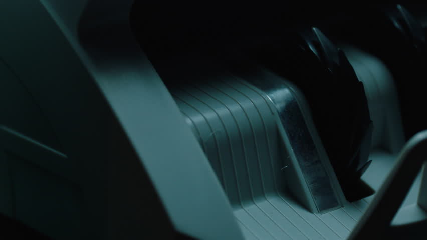 Pan across money counter counting Canadian currency. Filmed with Arri Alexa Mini