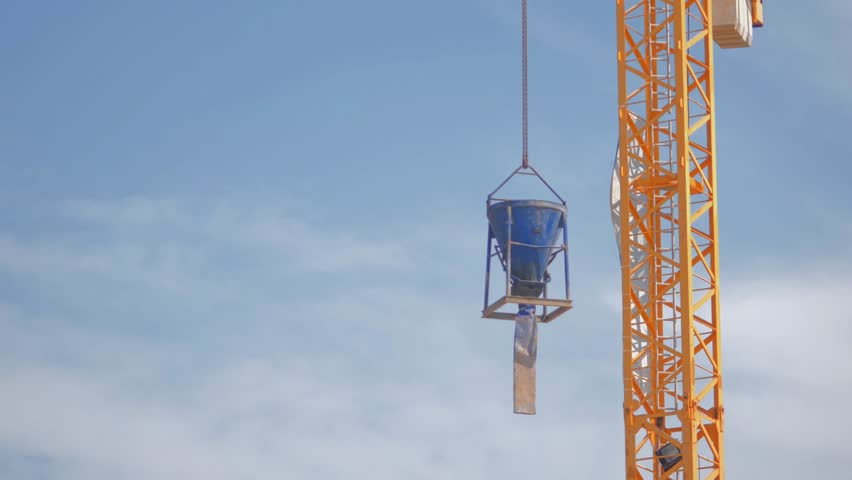 Construction yellow crane against the background of a blue sky.   Shutterstock HD Video #1025866709