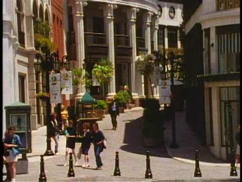 BEVERLY HILLS, CALIFORNIA, 1994, Street scene, curving walkway and stores