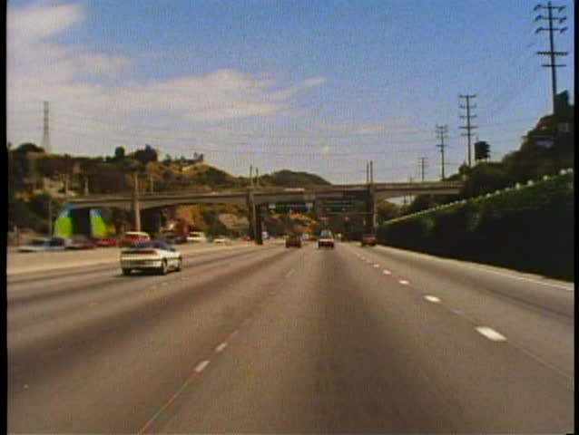 LOS ANGELES, CALIFORNIA, 1994, POV driving on the Hollywood Freeway, fast | Shutterstock HD Video #1025883149