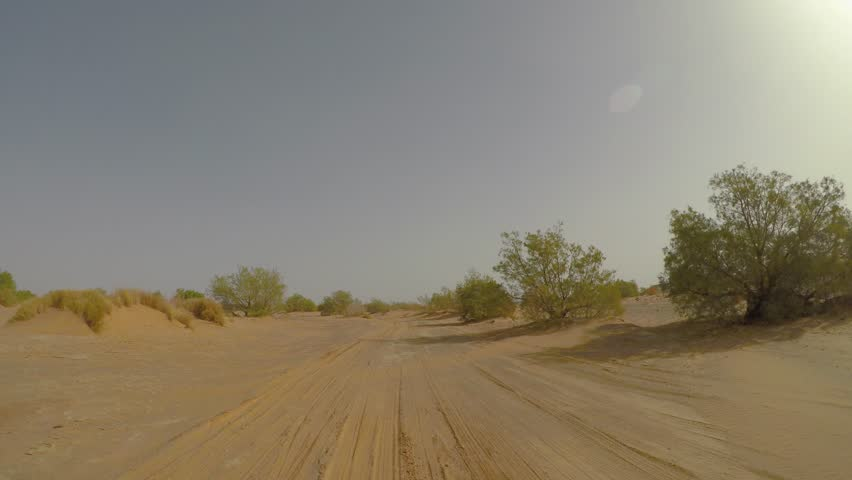 Car point of view drive in the Sahara desert. Part of Paris - Dakar route near Merzouga village in Morocco   Shutterstock HD Video #1025900609