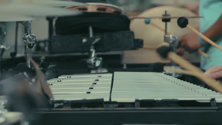 Cinematic closeup hands of high school marching band members playing xylophone and marimba in slow motion | Shutterstock HD Video #1025928629