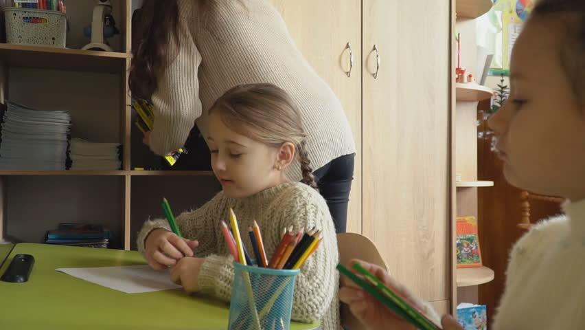 Children draw at school | Shutterstock HD Video #1025931989