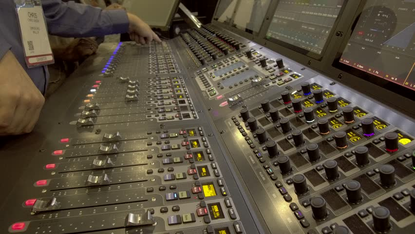 Handheld Shot of Sound Engineer Teaching Digital Audio Mixing Equipment.MOV | Shutterstock HD Video #1025958149
