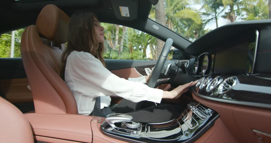 Woman entering car / Mercedes Benz E-class coupe / Los Angeles, CA 01.01.2019