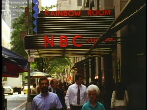NEW YORK CITY, 1994, NBC Marquee at Rockefeller Center, people pass