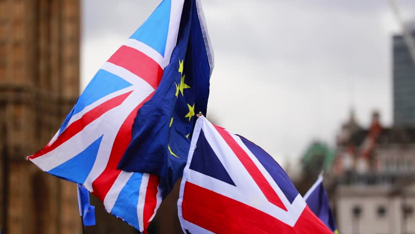 European Union and British Union Jack flag flying together. A symbol of the Brexit EU referendum | Shutterstock HD Video #1026040019