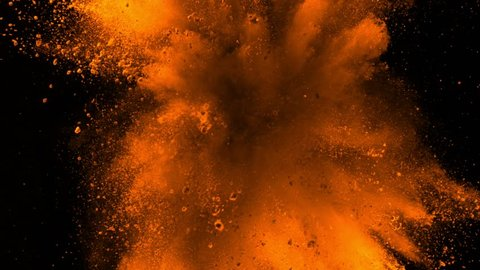Super slowmotion shot of golden powder explosion isolated on black background.
