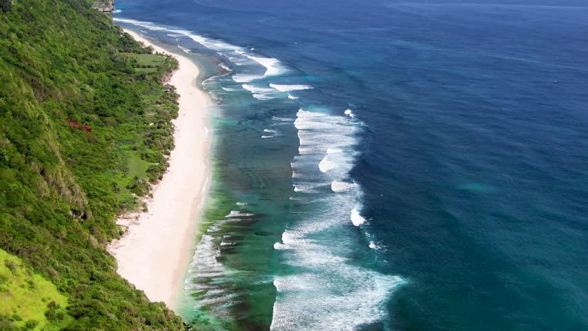Aerial flight over the beautiful shoreline of Nyang Nyang Beach Bali, Indonesia. | Shutterstock HD Video #1026317609