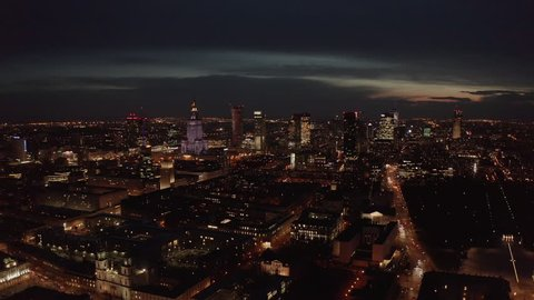 4K. Aerial shot of Warsaw city metropolis skyline at night. Spectacular aerial view of skyscraper city buildings at night.