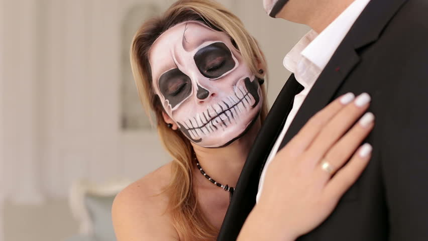 Luxury Young Couple With Halloween Skull Make Up In A Dress And Costume In A