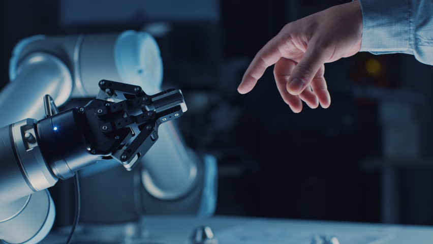 Futuristic Robot Arm Touches Human Hand in Humanity and Artificial Intelligence Unifying Gesture. Conscious Technology Meets Humanity. Concept Inspired by Michelangelo's Creation of Adam | Shutterstock HD Video #1026344129
