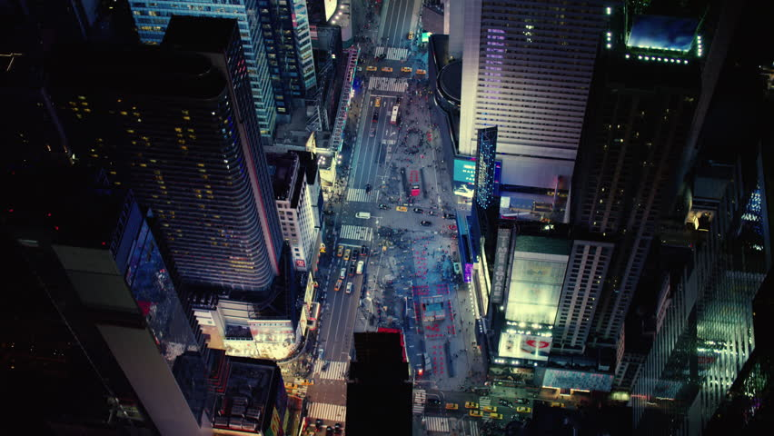 Aerial view of bright lights and busy night life in Times Square, New York City. Shot on 4k RED camera.
