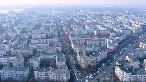 Bucharest / Romania - March 23, 2019: Aerial view of traffic jam in Bucharest. Gray day in the city. Crowded city. Block of flats in Bucharest. Aviatorilor area. Morning hours