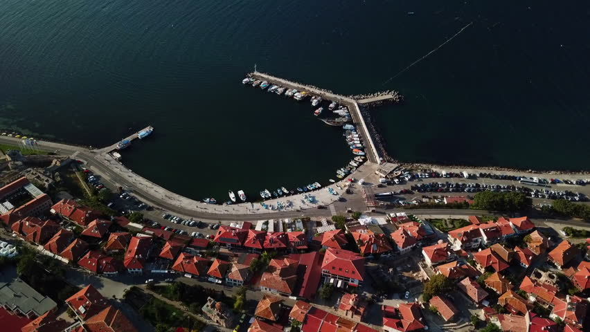 Flying over, aerial view of old Nessebar, ancient city on the Black Sea coast of Bulgaria, UNESCO World Heritage, marine