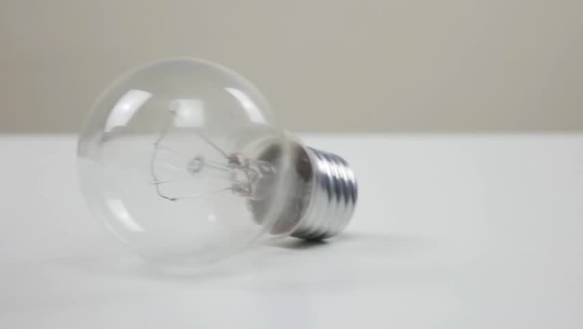 Light bulb rolling on white table | Shutterstock HD Video #1026508499