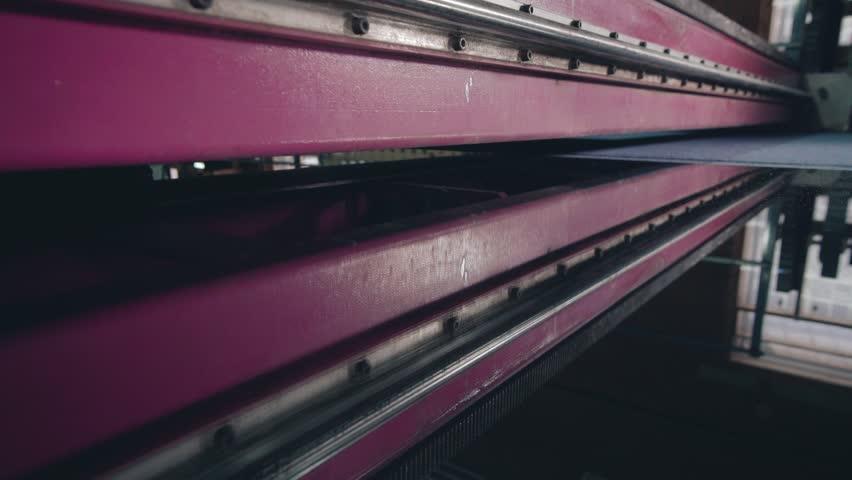 Machine makes a straight cut of glass   Shutterstock HD Video #1026512459