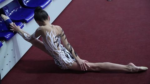 CHELYABINSK, RUSSIA - DECEMBER 02,2012:V Chelyabinsk Region Governor's Cup rhythmic gymnastics.Rhythmic gymnastic Training athletes in hall before event Young girl in dress makes gymnastic performance