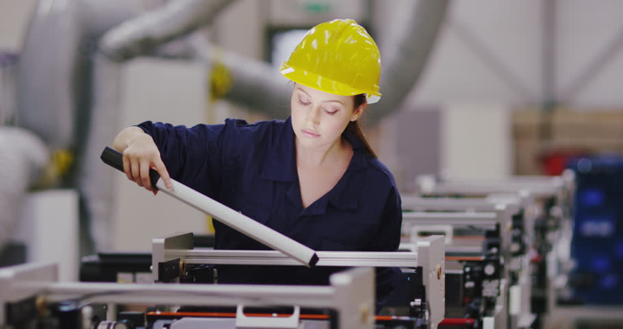 4K Female engineer looking at factory machines, doing servicing & repairs. Slow motion. | Shutterstock HD Video #1026605009