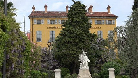 GRASSE, ALPS MARITIMES/FRANCE - APRIL 27, 2015: International perfume museum and Honore Fragonard statue, Grasse old town. The town is considered the world's capital of perfume.