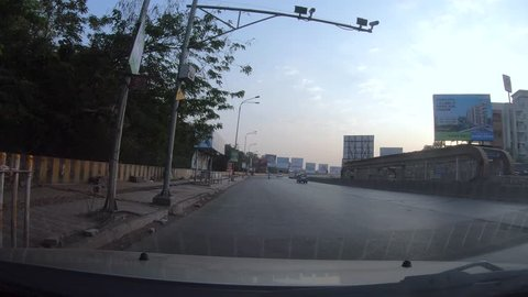 Pune, India - March 31 2019: Time lapse of driving through the streets of Pune India.