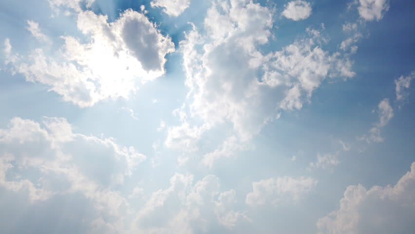 4k Timelapse low angle view cloudscape with wind blowing white fluffy clouds passing the sun in clear sky with sunlight shining through the cloud in sunny day. Heaven, dream and climate change concept   Shutterstock HD Video #1026679979