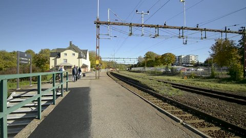 Ed, Dalsland / Sweden oct 4 2018: Train arrives at railway station in Ed Dalsland. People getting on and off train.