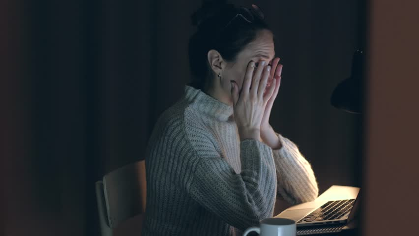 Beautiful Woman takes off his glasses and rubbing tired eyes. Female yawn and want to sleep. Problem with glasses, eyesight or vision. Working late with computer. Astigmatism, myopia or insomnia. | Shutterstock HD Video #1026688349