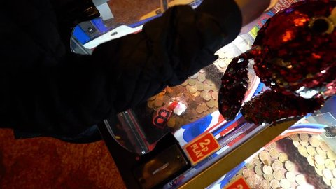Blackpool, Lancashire - 26th March 2019 Children play the famous 2p machines arcade machines at the amusements by Blackpool Tower and Blackpool pleasure beach in one of the UK's best tourist locations