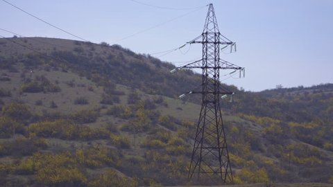 Huge high-voltage electrical supports over the forest