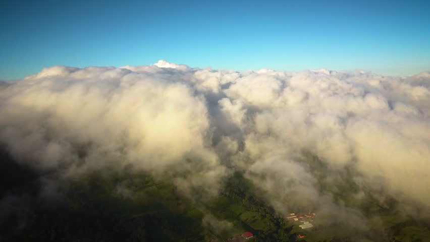 Cinematic drone shot flying into a dense sea of clouds. | Shutterstock HD Video #1026771119