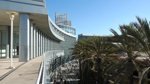 Anaheim, CA / USA - March 30, 2019: Exterior shot of the Anaheim Convention Center, taken from upstairs terrace. Crowds of attendees seen below.