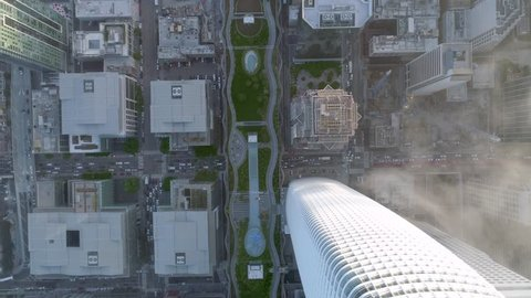 SAN FRANCISCO, CA, USA. Slow motion aerial 4K view of the San Francisco's financial district. Natural light and foggy airflow over the crowded streets of San Francisco.