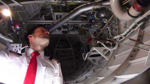 A corporate captain checks the aft avionics compartment of his aircraft.