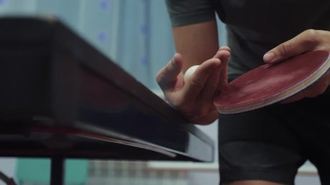 table tennis serve concept. lifestyle slow motion video. blurred focus on the grid. man playing training serve ball in table tennis the sport active
