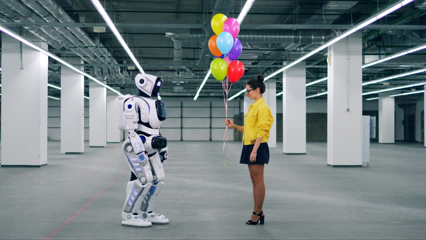 One girl gifting balloons to a robot in a room. | Shutterstock HD Video #1026880499