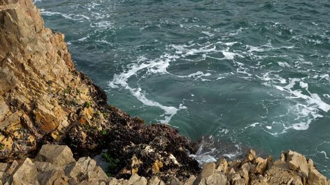 Knysna Heads, sea water surging onto rocks. Garden Route. Western Cape. South Africa.