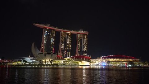 SINGAPORE CITY, SINGAPORE - MARCH 29, 2019 : laser show at night above Marina Bay Sands Hotel Casino at Marina Bay Waterfront in Singapore. Popular free evening show performed every night