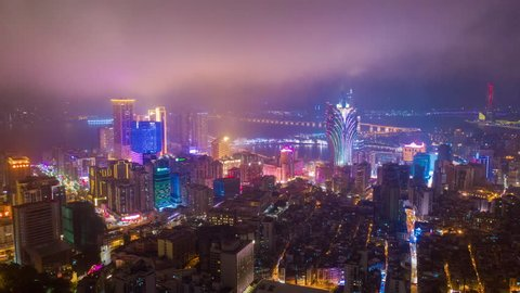night illumination flight over macau city hotel downtown bay aerial panorama 4k timelapse china