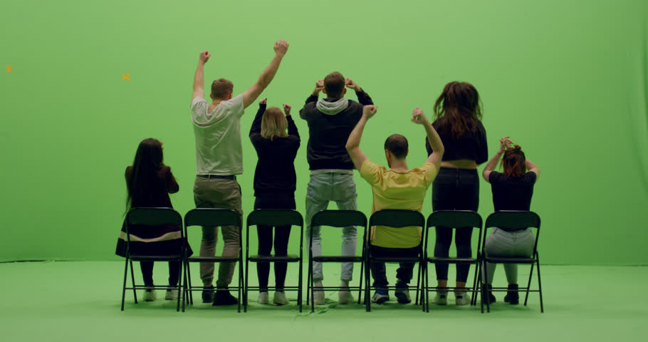 GREEN SCREEN CHROMA KEY Back view group of young people watching and cheering at a sport event. 4K UHD ProRes 4444