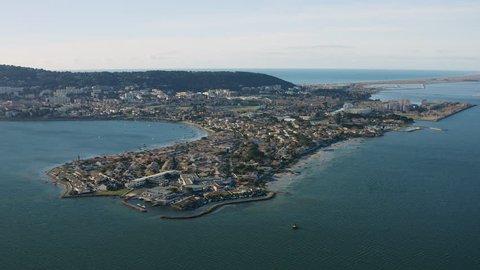Pointe du Barrou in Sète aerial drone view over the Etang de Thau and mediterranean sea vineyards touristic city France