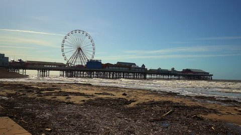 Stunning aerial view of the famous Blackpool pier at high tide, by the award winning Blackpool beach, A very popular seaside tourist location in England , United Kingdom, UK