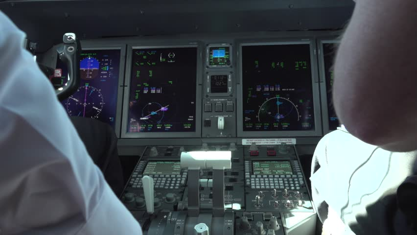 Pilot controls the aircraft. Control element of an airplan. Panel of switches on an aircraft flight deck. Thrust levers of a twin engined airliner. Onboard computer, cockpit | Shutterstock HD Video #1027307039