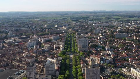 Aerial view Jean Jaures avenue with green trees in Nîmes France sunny day