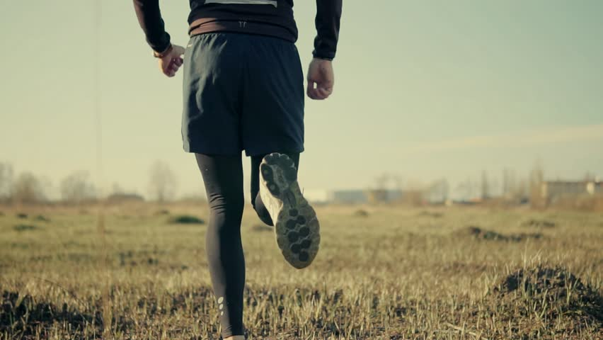 Runner Legs Close-Up Jogging In Slow Motion.Man Running Slow Motion On Field.Close Up Foot And Running Shoes.Male Workout For Marathon Race.Man Athlete Legs Jogging Back View.Sport ,Recreation Concept | Shutterstock HD Video #1027360619