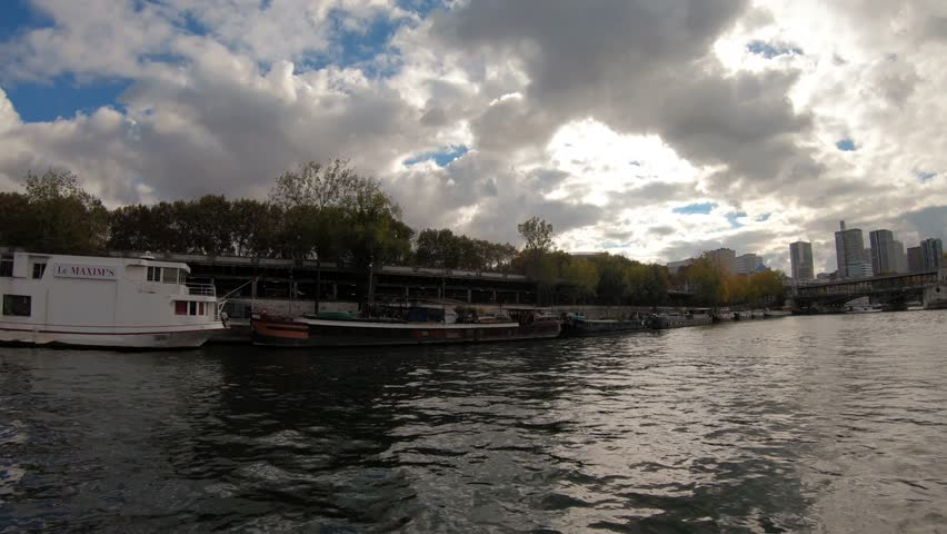 Hyperlapse time lapse point of view from a cruise boat on Seine river bridges Eiffel tower view Paris city on sunny day | Shutterstock HD Video #1027401749