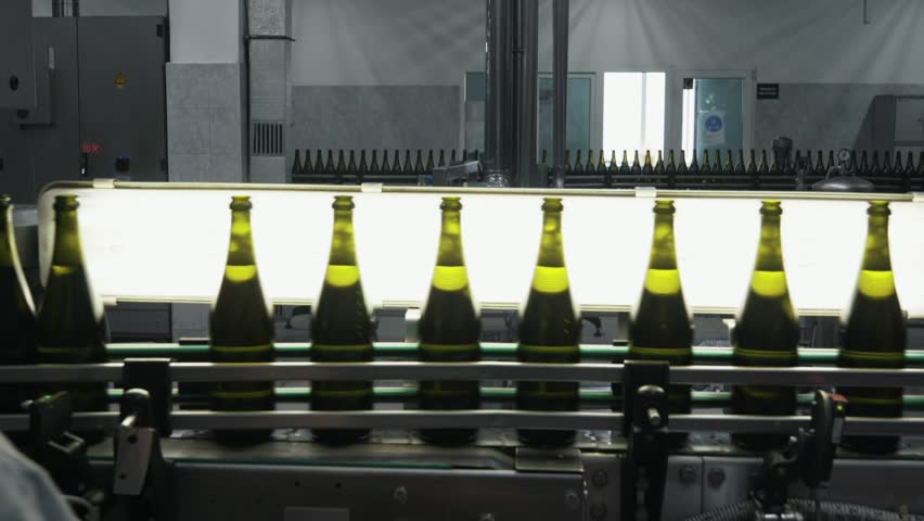 Bottles with alcohol move along automatic conveyor belt, quality control at champagne factory. Concept wine production | Shutterstock HD Video #1027402679