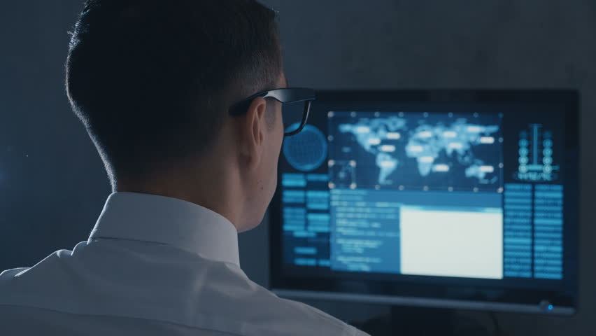 IT professional programmer is working on computer in cyber security center   Shutterstock HD Video #1027423109